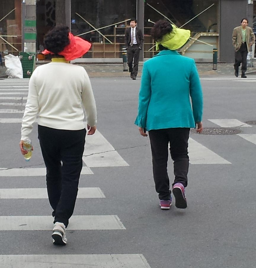 Figure 1: The Visor. These women are determined to have nothing stand between them and an ageless complexion.